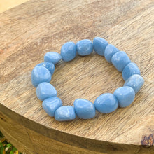Load image into Gallery viewer, Shop for Blue Angelite Tumbled Gemstone Bracelet at Magic Crystals. We carry 6-8 mm Angelite, Stretch Bracelet, Tumbled Stone Bracelet for gift or you. Jewelry Bracelets, and Beaded Bracelets. Tumbled Stone Bracelet, Angelite Jewelry. FREE SHIPPING available.