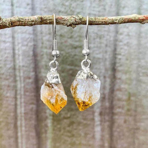 Check out our CITRINE Earrings - Birthstone, Raw Stone Jewelry, Dangle Earrings, Healing Crystals, Silver Earrings when you shop at Magic Crystals. What is Citrine? Citrine is a mineral, member of the Quartz family. Citrine Crystal meaning is ABUNDANCE and MOTIVATION. Citrine stone benefits and more.
