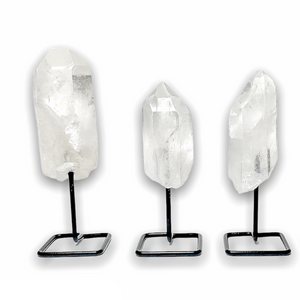 Shop from MagicCrystals.Com One Rough Clear Quartz Metal Stand, Clear Quartz Chunk on Stand, Point on Stand Pin, Clear Quartz Protect Stone, Rough Clear Quartz, Raw Clear Quartz! We carry a wide variety of clear quartz gemstones and quartz specimens. FREE SHIPPING AVAILABLE.