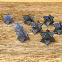 Load image into Gallery viewer, Merkaba Healing Crystals are known for activation of the Light Body merged with the Physical Body in Awakening deep Spiritual Transformation. Shop for Iolite Stone Crystal Merkaba - Sacred Geometry Star at Magic Crystals. Magiccrystals.com has Merkaba Necklace, gemstone Merkabahs, and Sacred Geometry sets