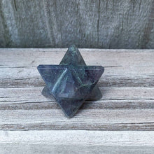 Load image into Gallery viewer, Merkaba Healing Crystals are known for activation of the Light Body merged with the Physical Body in Awakening deep Spiritual Transformation. Shop for Iolite Stone Crystal Merkaba - Sacred Geometry Star at Magic Crystals. Deep Blue Iolite 8 Point Merkaba Star Polished, Merkaba Necklace, gemstone Merkabah.