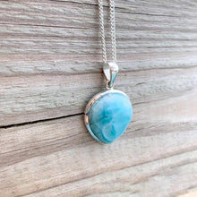 Load image into Gallery viewer, This lovely, rare and spectacular mineral gem called Larimar is a blue pectolite found in the Dominican Republic. Shop Genuine Larimar Necklace set in Sterling Silvera at Magic Crystals. We carry Larimar Pendant, Sterling Caribbean Larimar Necklace, Gift For Her, Gemstone Pendant. Magiccrystals.com carries the essence of the ocean.