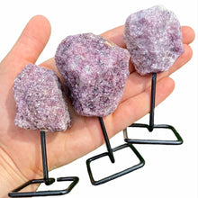 Load image into Gallery viewer, Lepidolite Point on Stand. Looking for One Rough Black Lepidolite Metal Stand, Lepidolite Chunk on Stand, Point on Stand Pin, Lepidolite Stone, Rough Lepidolite, Raw pink and purple stones? Shop for our genuine gemstones. FREE SHIPPING AVAILABLE at Magic Crystals ! Lepidolite Gemstone for OPTIMISM AND BALANCE