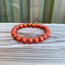 Load image into Gallery viewer, Looking for Red Jasper Jewelry? Shop at Magic Crystals for Red Jasper Beaded Bracelets. Natural Red Jasper Unisex Elastic Bracelet. Red jasper is a stone of physical strength, a vitality that can help with the stabilization of one's energy. FREE SHIPPING available. Natural Healing Gemstone Buddha Charm Bracelet, red jasper earrings, and rings.