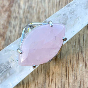 "Pink Stone ring. Pink Jewelry. Rose Quartz Stone Ring and Natural Rose Quartz Jewelry at Magiccrystals.com . Rose Quartz rings help to encourage healing. Rose Quartz rings. Rose quartz is often called the ""Love Stone."" It's energetic hallmark is that of unconditional love that opens the heart chakra."