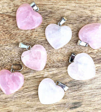 Load image into Gallery viewer, Looking for metaphysical facts about rose quartz necklace? Well you're in luck, because here they come. Shop for the best quality semi precious rose quartz stone heart necklaces and pendants in magic crystals. Cuarzo Rosa en forma de corazon. FREE SHIPPING available. Heart Chakra.