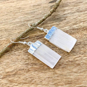 Did you scroll all this way to get facts about selenite? Selenite is like liquid light. Shop for Selenite Crystal Earrings - Raw Crystal Earrings - Selenite Stone Earrings - Wife Gift For Her - Selenite Jewelry in Magic crystals. Beautiful purification crystal set in silver. FREE SHIPPING available.