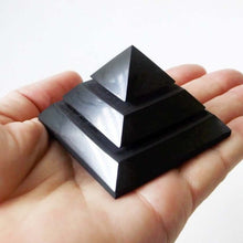 Load image into Gallery viewer, Medium Shungite Energy Pyramid from Russia. Shungite Sakkara Polished Pyramid 10cm, Chakra Healing Stone, Block EMF's WIFI Radiation 5G. Metaphysical Properties of Shungite is an extremely earthy stone that is wonderful for easing geopathic stresses such as harmful electromagnetic pollution, smog, and frequencies.