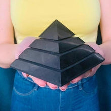 Load image into Gallery viewer, Large Shungite Energy Pyramid from Russia. Shungite Sakkara Polished Pyramid 10cm, Chakra Healing Stone, Block EMF's WIFI Radiation 5G. Metaphysical Properties of Shungite is an extremely earthy stone that is wonderful for easing geopathic stresses such as harmful electromagnetic pollution, smog, and frequencies.