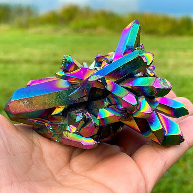 Looking for Rainbow Aura Amethyst Cluster - Titanium Rainbow Aura Quartz Crystal Cluster,Rainbow cluster 140 grams  (Titanium Aura Quartz)? Shop at Magic Crystals for a wide variety of original aura quartz. magiccrystals.com offers FREE SHIPPING.itanium rainbow aura quartz will help ground, balance, and center you.