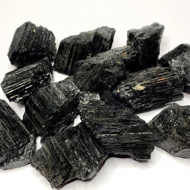 Shop for Black Tourmaline Crystal Chunks -  Rough Tourmaline at Magic Crystals . Black Tourmaline is a perfect mineral to protect your aura. FREE SHIPPING available. Tourmaline Raw stones. Genuine black tourmaline discs, pointers, crystals and stones.