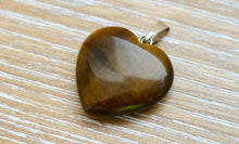 Load image into Gallery viewer, Looking for the best selection of tigers eye necklace? Well you're in luck, because here they come. Shop genuine Yellow Tiger Eye Stone Heart Necklace and Pendant made from natural gemstones. Tigers Eye Necklaces : Free Shipping. Whatever its style, the tiger eye necklace is always beautiful. Heart pendants & necklaces
