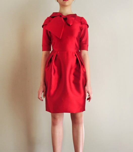 Distinctive Silk Wool Dress with Pig Skirt Feature, Sumptuous Accent Bow & 3 / 4 Cup Sleeves & Side Pockets