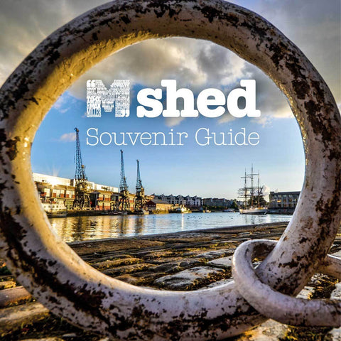 M Shed souvenir guide book cover showing the museum from across the harbour