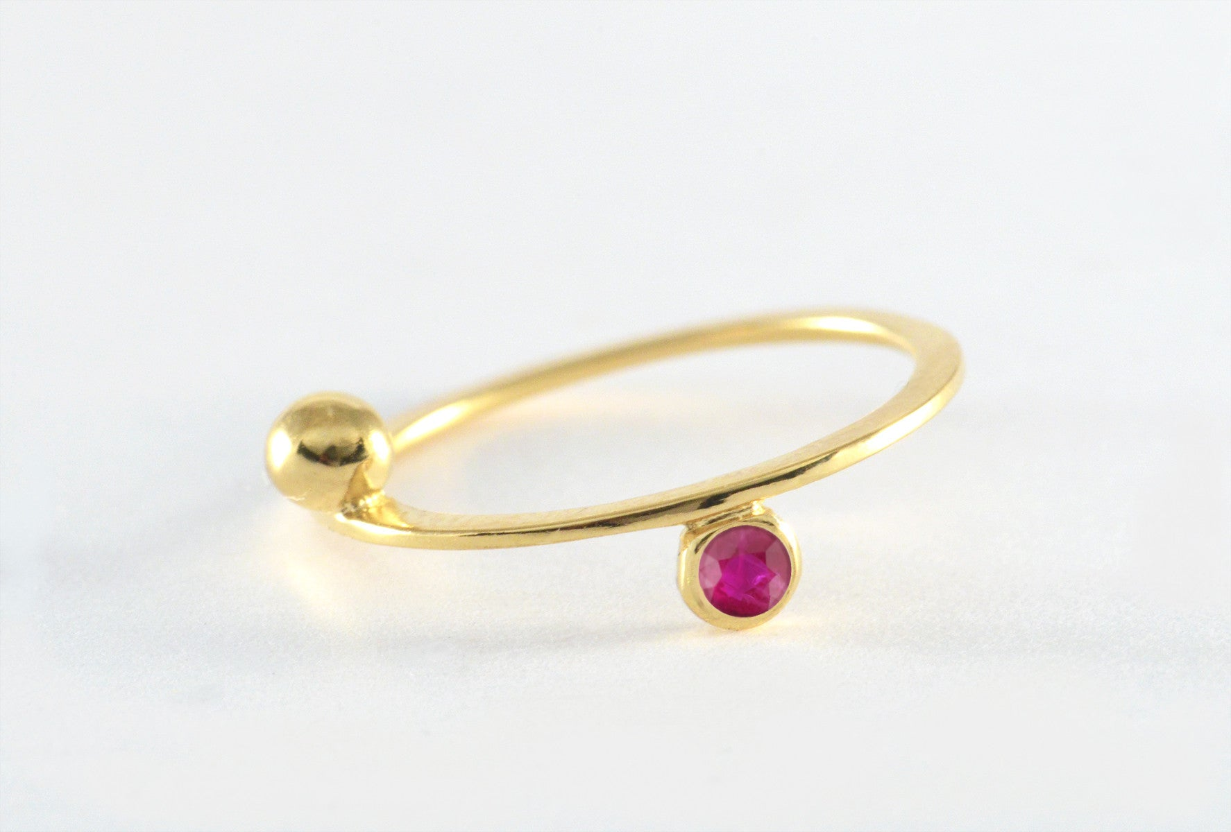 Floating Saturn Ruby Ring