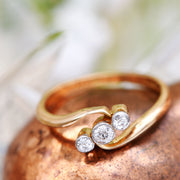 The Early 20th Century Crossover Trilogy Diamond Ring - Antique Jewellers Ltd