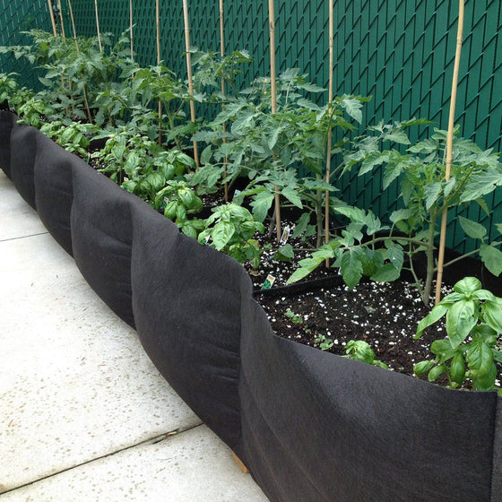 Smart Pot® new fabric raised bed—a size for every situation. Smart Pot® Long Bed Pots come in 6 ft, 8 ft and 12 ft long x 16 in wide and tall. Inserts placed internally in bed aid in keeping raised beds upright. Perfect for large garden installations; no construction required. The Big Bag Bed also air prunes roots while protecting plants from underground pests like gophers and moles. Just unfold, fill and plant! Soil volume: 6 ft - 10.7, 8 ft - 14.2 and 12 ft - 21.4 cu ft. Growing area: 6 ft - 8 sq ft, 8 ft