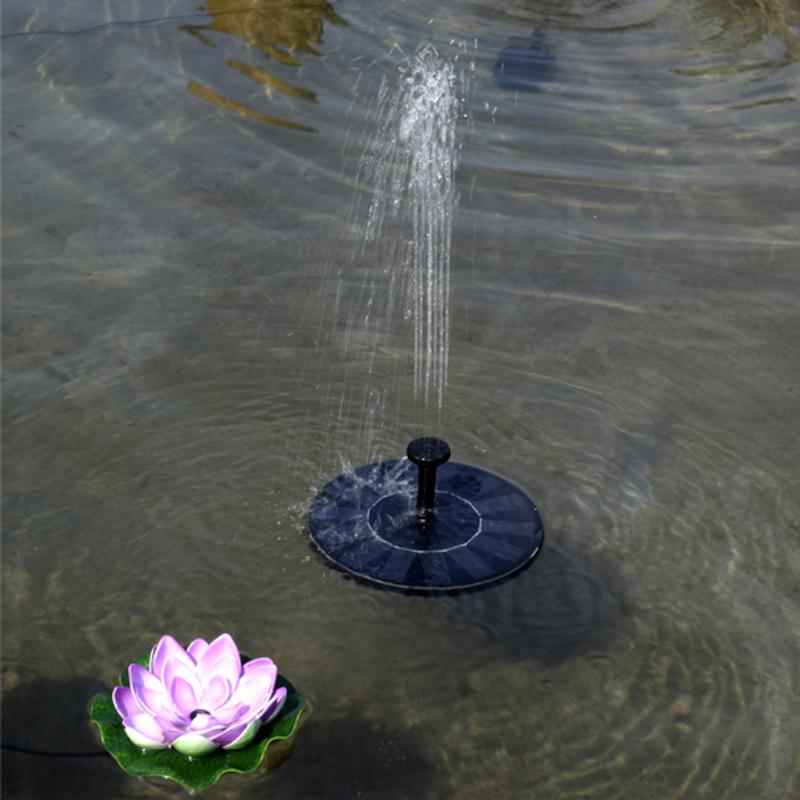 solar water fountain in pond