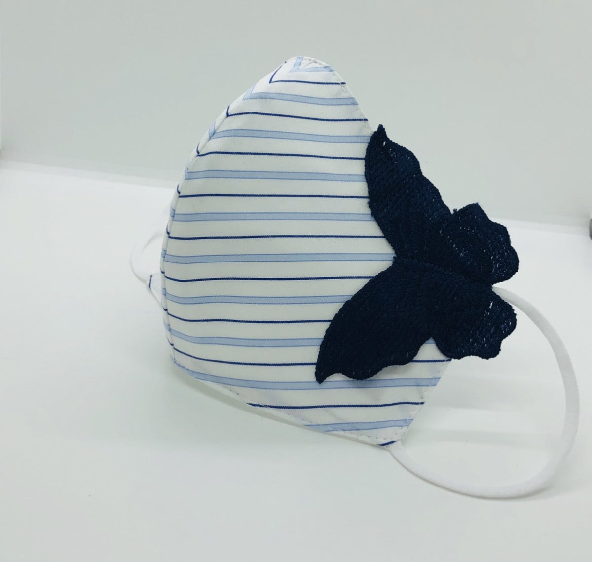 Striped face shield with butterfly accent