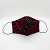 Cover Face Black laser-cut suede with a red cotton underlay By Ludmila Couture