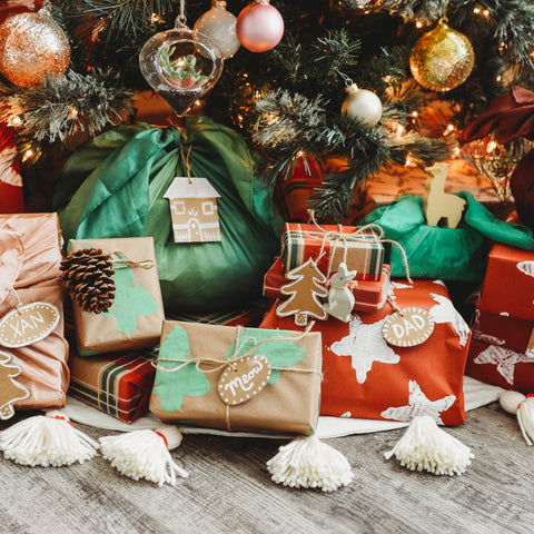 Eco-friendly recycled wrapping paper, cardboard gift tags, and cloth gift wrapping.