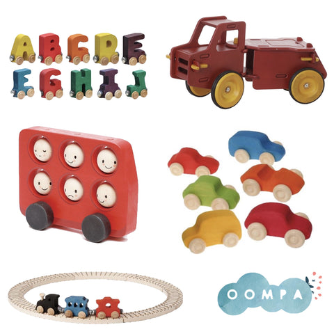 A collection of wooden vehicles from Oompa Toys