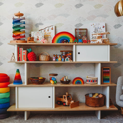 A playroom shelf after a toy rotation.