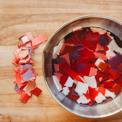 Wildflower seed bomb Valentine soaking paper scarps in a metal bowl