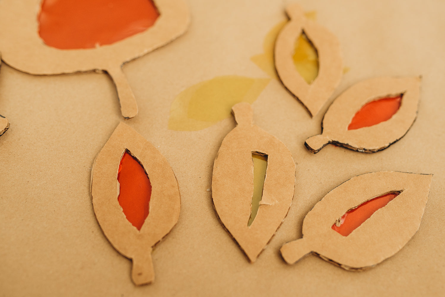 Series of cardboard leaves for an eco-friendly fall craft project.