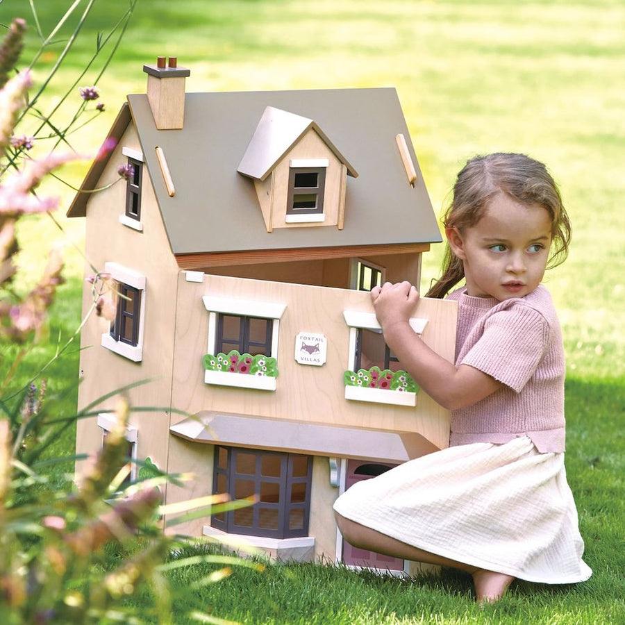 Girl Playing with Tender Leaf Toys Foxtail Villa Dollhouse