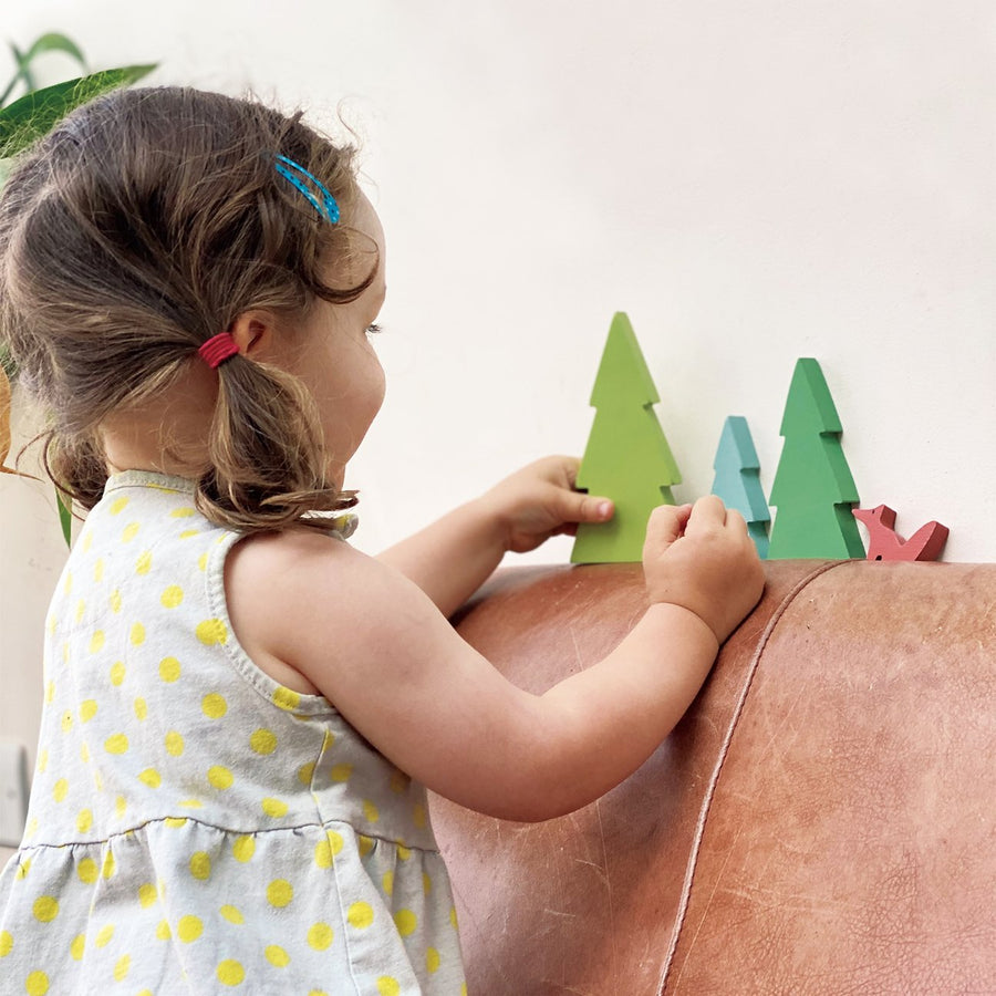 Girl Playing with Tender Leaf Toys Fir Tree Tops - Oompa Toys