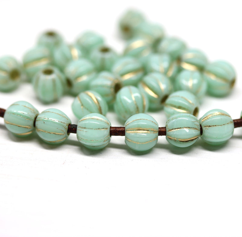 1.5mm hole Mint green golden stripes 6mm melon shape beads - 30pc