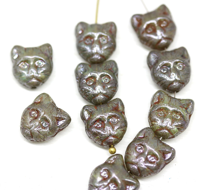10pc Picasso cat head beads, green Czech glass feline beads