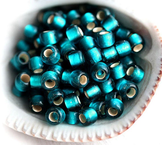 6/0 Toho seed beads,  Silver Lined Frosted Teal, N 27BDF - 10g