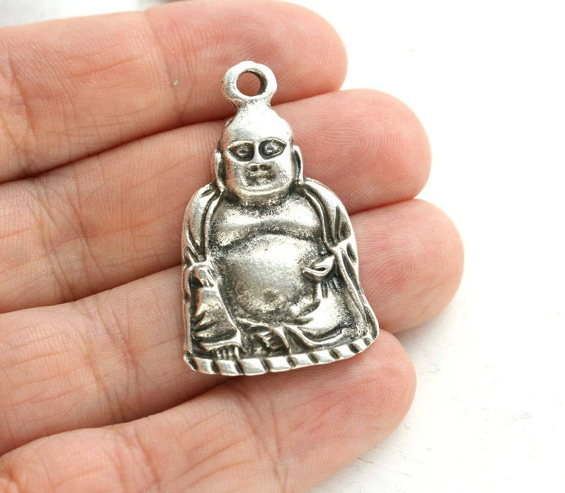Antique silver Buddha figure pendant