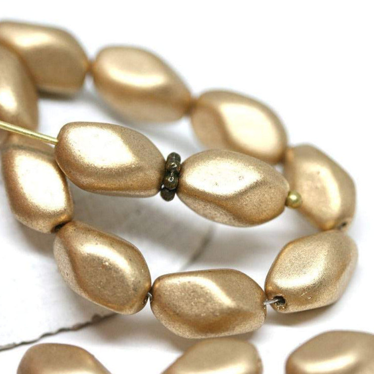 11x7mm Matte Gold czech glass barrel beads Druk oval twist - 20Pc