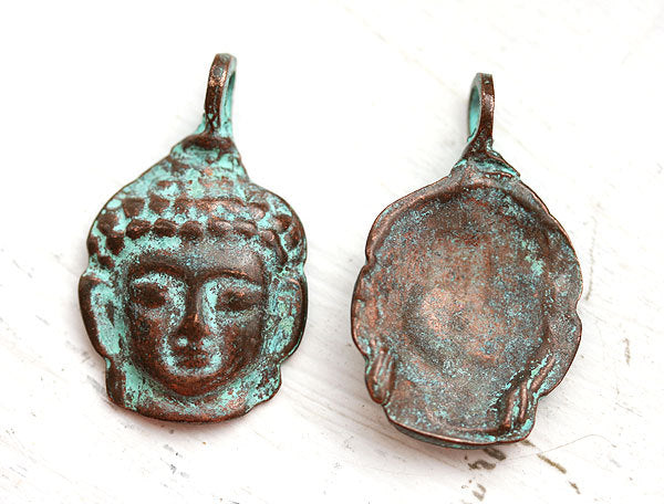 Buddha face Green patina on copper pendant