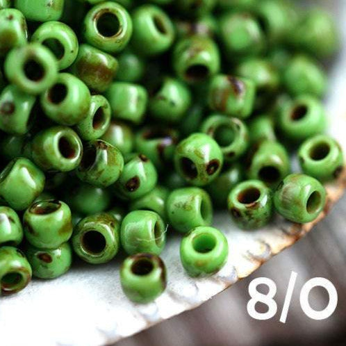 8/0 Toho seed beads, Opaque Mint Green Picasso, Y321, hybrid - 10g