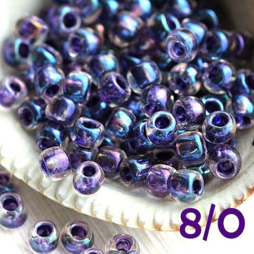 8/0 Toho seed beads, Inside Color Rainbow Crystal Tanzanite Lined N 181, blue purple - 10g