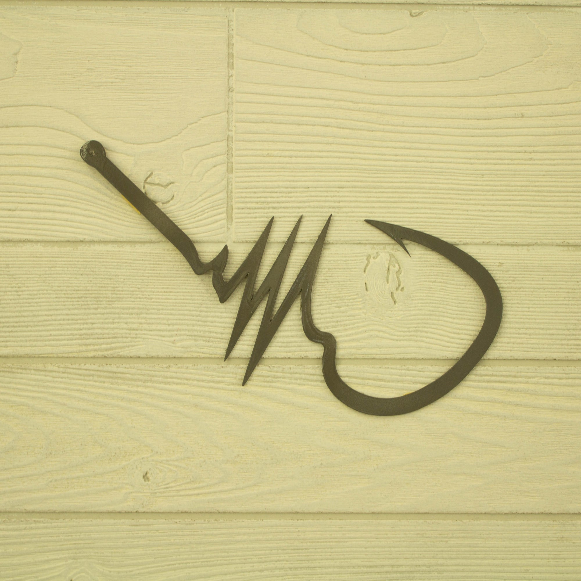 Fish Hook with Heartbeat - open spaces metal art