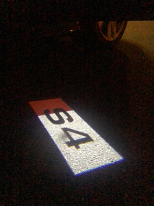 AUDI  LOGO PROJECTOT LIGHTS Nr.131  (quantity 1 = 2 Logo Films /2 door lights)