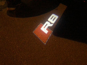 AUDI  LOGO PROJECTOT LIGHTS Nr.124  (quantity 1 = 2 Logo Films /2 door lights)