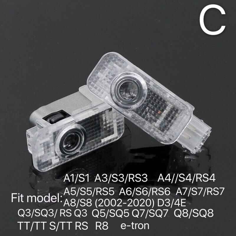 AUDI  LOGO PROJECTOT LIGHTS Nr.132  (quantity 1 = 2 Logo Films /2 door lights)