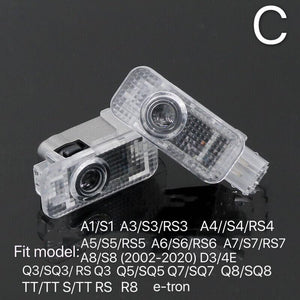 AUDI  LOGO PROJECTOT LIGHTS Nr.102   (quantity 1 = 2 Logo Films /2 door lights)