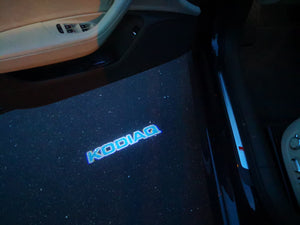 SKODA LOGO PROJECTOT LIGHTS Nr.99 (quantity  1 =  2 Logo Film /  2 door lights)