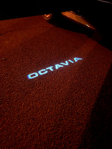 SKODA LOGO PROJECTOT LIGHTS Nr.104 (quantity  1 =  2 Logo Film /  2 door lights)