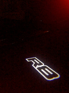 AUDI  LOGO PROJECTOT LIGHTS Nr.123  (quantity 1 = 2 Logo Films /2 door lights)