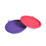 Stainless steel cat bowls with purple and watermelon coloured lids on