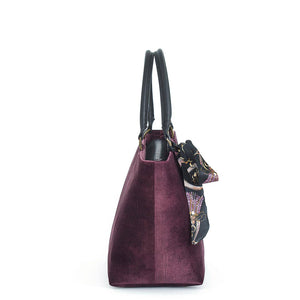 Side view of Aubergine Velvet Grab Bag with black leather handles & Twilly Scarf, by Umpie Bags