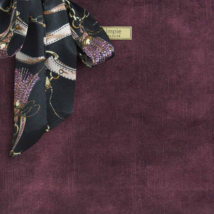Close up view of Aubergine Velvet Grab Bag with black leather handles & Twilly Scarf